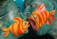 A fish relationship done in face paint, you have to go to the website to see the whole series--so cool!