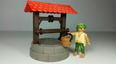 Playmobil pozo con aldeano belen