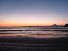 A beach reflecting sunset glow at Zushi.