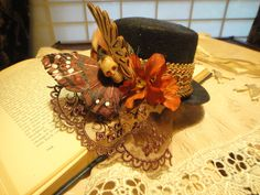 Steampunk Butterfly- Black Mini Top Hat - Nautral Pheasant Feathers Hawkmoth Skull Butterfly Floral Brown Lace Veil Fascinator. $45.00, via Etsy.