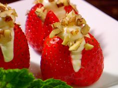 Cream Cheese and Pecan Stuffed Berries from FoodNetwork.com...Can use mini chocolate chips or graham cracker crumbs instead of nuts.