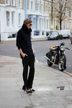 navy funnel neck by Massimo Dutti layered over an Isabel Marant mesh top, zip-up suit pants by Nowhere and Zara cut-out pumps