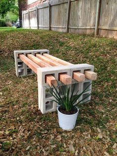 Put together a super simple bench with cinder blocks and 4x4s. | 31 Clever Ways To Decorate Your Outdoor Space #Summer Activities, Kid Activities, Summer Kid Activities