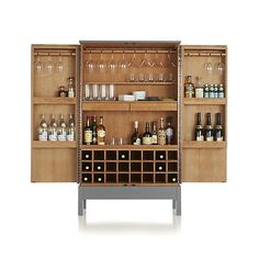 Victuals Grey Bar Cabinet in Bar Cabinets & Bar Carts | Crate and Barrel A bar cabinet that actually has enough storage for everything! Plus a drawer for all those little gadgets (hello) and a pull-out cutting board. Wine, liquor, mixers, bitters, wine glasses, bar glasses, ice bucket, shakers...it'll all fit. Thank you. Now if I just had the $2,500 for it...