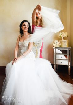 The Armenian tradition of the maid of honor placing the veil on the bride