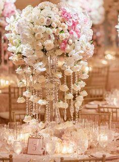 Photographer: KLK Photography; Pink wedding reception centerpiece idea