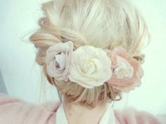 updo with flowers for a wedding or a reception! just add the colors of flowers as your reception to match :D cute idea!