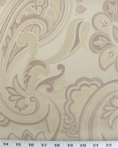 Medium Weight Drapery / Medium Weight Upholstery A jacquard paisley and floral pattern in champagne and beige. This fabric pairs with several others in the same colorway.