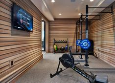 """This is the perfect example of what you can achieve with limited space. Ronda divers Interiors have created a neutral design which offers calm & solidity for your workouts. The lighting is no intrusive. The wall mounted racks offer a multitude of workout variations"""