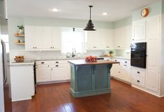 Combines all of my ideas. Wall color, white cabinets, dark grout, gray/blue Island, black and wood accents