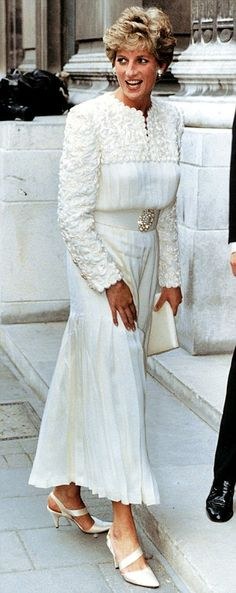 Diana, May 1993. She is wearing a lace and pleated chiffon by Jacques Azagury.