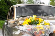 Buy Wedding car by KYNASTUDIO on PhotoDune. Close-up of vintage wedding car decorated with flowers Wedding Car, Stock Photos, Flowers, Vintage, Candid, Photographs, Smile, Lifestyle, Studio