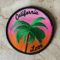 """Round iron-on patch with palm tree & sunset. Dimensions- Round 3 1/2"""" by 3 1/2""""."""