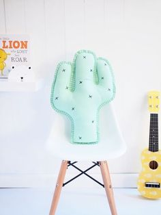 Add a fun vibe to your kids room with a cactus cushion