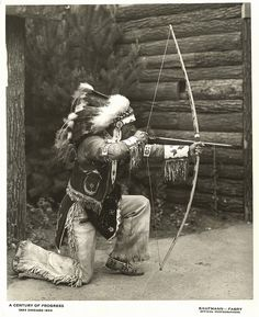 [American Indian demonstrating the use of a bow and arrow] by UIC Digital Collections, via Flickr