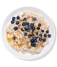 Oatmeal With Blueberries, Sunflower Seeds, and Agave - 1 serving quick-cooking or old-fashioned rolled oats;  1/2 cup blueberries; 1 tbls sunflower seeds; 1 tbls agave nectar