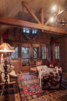 Western Rustic Cabin Decor - love the cow hide!