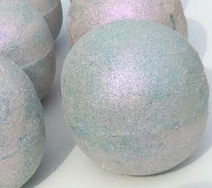 Item No. NBB0103 When it comes to bath bombs, we don't mess around! Beautifully scented with neroli oil, citrus oil, coconut oil, lemongrass oil and treated with an iridescent mica rub, these large ba