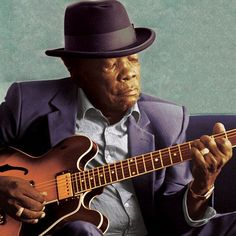 "John Lee Hooker. I had the privilege of seeing him perform live. ""ah haw haw haw"""