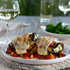 Eggplant Parm Rolls: Grilled eggplant slices filled with cheese and herbs, baked in a chunky vegetable tomato sauce