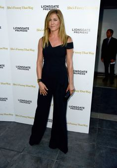Jennifer Aniston's form-flattering jumpsuit by Roland Mouret and gold jewelry. See 5 other celebrities whose late summer style killed it.
