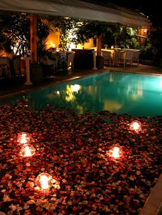 1000 images about water lights on pinterest pool candles water candle and floating candles for Floating candles swimming pool wedding