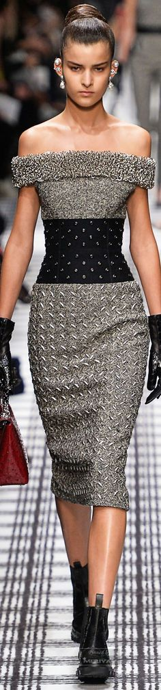 Balenciaga.Fall 2015. There is nothing I don't love about this dress: the skirt looking like pressed steel, the studded waist, off the shoulder, the textures, even the cool ear jewelry!!! Love LOVE LOvE!!!!