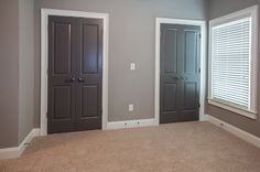 I have the lighter gray on the walls. And plan on painting the trim white and was pondering a new door color. The wall color is Sherwin Williams 7642 Pavestone and the door color is Sherwin Williams 7019 Gauntlet Grey Interior Door Colors, Interior Door Styles, Home Interior, Interior Design, Dark Interior Doors, Painted Interior Doors, Dark Doors, Grey Front Doors, Wall Colors