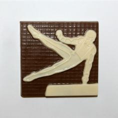 A gymnast plaque of an athlete performing on the pommel horse. Perfect gift for yourself or other Gymnastics fan! Available in Delicious Milk, Dark or White Chocolate.