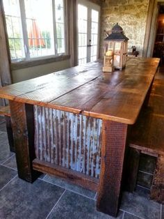 "This farmhouse table is built with wood strait from the family barn. Notice how wide the planks are (18"" each). The tin is also from the barn.  The benches are"