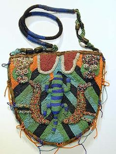 Yoruba Bag | Nigeria | Used to carry divination objects and tools, the bags are worn in public ceremonies by Ifa priestesses and used and displayed in their homes. Beads were signs of wealth and status. The beaded front lifts up to reveal a pouch on the back panel.