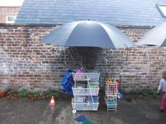 large umbrellas for creative area outdoors #abcdoes #outdoorprovision #eyfs