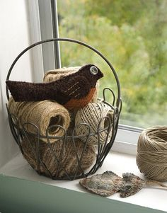 I love this idea.. and I have old twine balls.. .or vintage crochet thread!