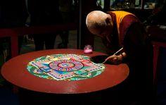 """A Tibetan Monk creating a Mandala at """"Festival dell'Oriente 2012"""" in Carrara, Italy."""
