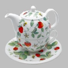 Made of fine bone china, this teapot for one is a charming addition to any decor.  Covered with luscious strawberries and strawberry vines, it is truly a cheerful pattern and one of the most popular products from Berta Hedstrom.  Capacity: Cup 7oz, teapot 14oz, 5 1/2' high.  Made in England