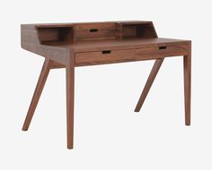 Scandinavian Designs - Instill a Scandinavian feel into your workspace with the Abroma desk. Crafted from solid walnut with clean lines and tapered angled legs, this modern desk featu