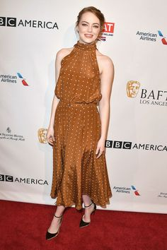 Emma Stone in Diane von Furstenberg top and skirt, Jimmy Choo shoes, Alezan ring and Sara Weinstock and EF Collection earrings.
