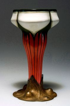 """""""Walter Scherf. Vase, 1899-1900. H. 21.5 cm. Made by Walter Scherf & Co., Nuremberg, fayence by Vilmós Zsolnay, Pécs. Gilt pewter, fayence with with, green and pink glazing. Marked: """"""""OSIRIS"""""""" 519."""" 07/900E"""
