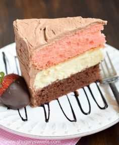 Neapolitan Cheesecake Cake: a layer of chocolate cake and a layer of strawberry cake with a cheesecake center. All wrapped in a fluffy chocolate buttercream frosting!
