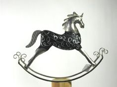 Rocking Horse by Made In India. Save 28 Off!. $25.00. Wood & metal. This decorative rocking horse is a unique artsy accent for any decor theme. The elegant wooden body of the horse is rich and enhanced by metal legs, saddle and head. Measure 21 in. H x 23 in. W x 5 in. D.