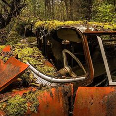 What nature gives... I can see it in front of me. Once there was a  proud owner cruising around in this bright red and shiny work of art. The person was young and had the whole life ahead and the car was brand new. What nature gives nature takes.  #day #autumn #fall #old #car #trees #leaves #woods #forest #mist #light #red #green #color #colorful #view #landscape #nature #life #young #age #obsolete #classic #vintage #sweden #jani #sony #photooftheday #decay #moss