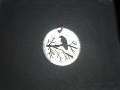 Awesome Etsy listing at https://www.etsy.com/listing/157203231/crow-silhouette-silver-pendant-and