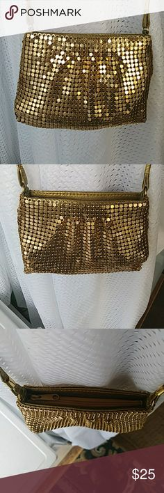 Small golden Art Deco bag This is a very petite bag, made for makeup or ID. It is a beautifully made golden aluminum mesh purse. Would catch anybody's eye when seen. Very exotic to touch prestige International Bags