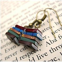 Gift ideas for book lovers: Get her the most adorable book earrings ever.