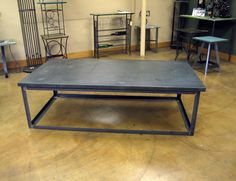 Steel frame and metal sheet coffee table