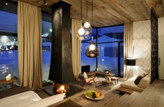 fireplace, timber interior, sunken rooms, walls of glass and thick drapes - yes please
