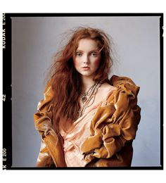 IRVING PENN again, his photos are similar to horst's in a lot of ways with his back and white photographs containing a sense of mystery and elegance.  i enjoy this image in colour because of the muted cool undertones tones that are contradicted by warmer clothing and hair colour