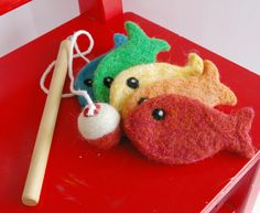 Go Fish -- Felted Wool Magnetic Fishing Game (Pole, Fish, Bag and Playsilk Set, All Natural). $42.00, via Etsy.