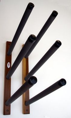Surfdogz - 3 SUP, Steel Peg / Wood Base Wall Rack Set by Surfdogz. $90.00. High quality foam padding with soft plastic end caps. Solid hardwood base, galvanized steel pegs. Heavy duty construction, fully assembled, includes mounting hardware.. Strong, safe, horizontal, wall storage for Stand Up Boards. Surfdogz stand up paddle board racks are designed to provide strong, safe, horizontal, wall storage for boards of all sizes. The base is solid hardwood, with a light oak stain, ...