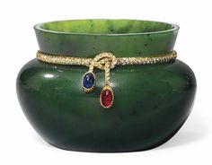 A JEWELLED SILVER-GILT MOUNTED NEPHRITE BOWL  BY FABERGÉ, CIRCA 1900, SCRATCHED INVENTORY NUMBER 8790  Of cauldron form, the slightly flared neck encircled with a diamond-set collar with cabochon ruby and sapphire terminals, unmarked 1¾ in. (4.4 cm.) high